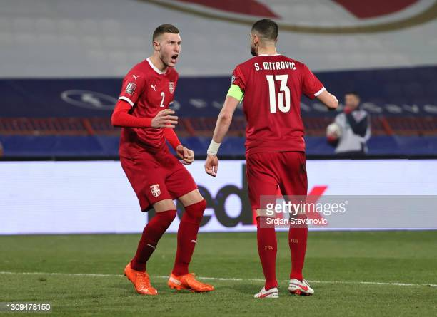 Strahinja Pavlovic and Stefan Mitrovic of Serbia react during the FIFA World Cup 2022 Qatar qualifying match between Serbia and Portugal at FK Crvena...