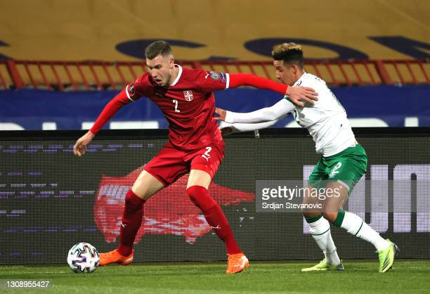 Strahinja Pavlovic of Serbia is closed down by Callum Robinson of Republic of Ireland during the FIFA World Cup 2022 Qatar qualifying match between...