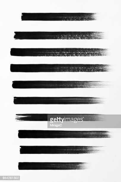 straight black brush strokes set - einzellinie stock-fotos und bilder