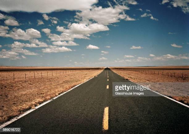 Straight Empty Road Through Desert Landscape, Arizona, USA