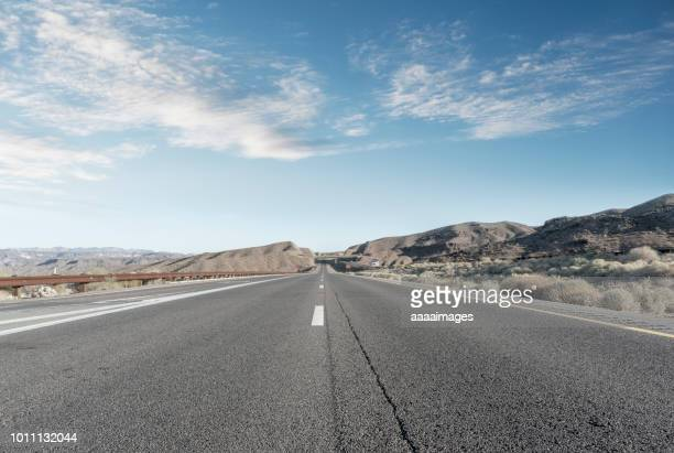 straight endless road through desert - eternity stock pictures, royalty-free photos & images