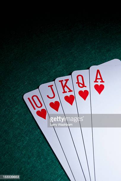 a straight flush fanned out on a table - royal flush stock photos and pictures