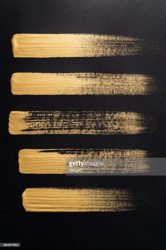 Straight Gold Brush Strokes : Stock Photo