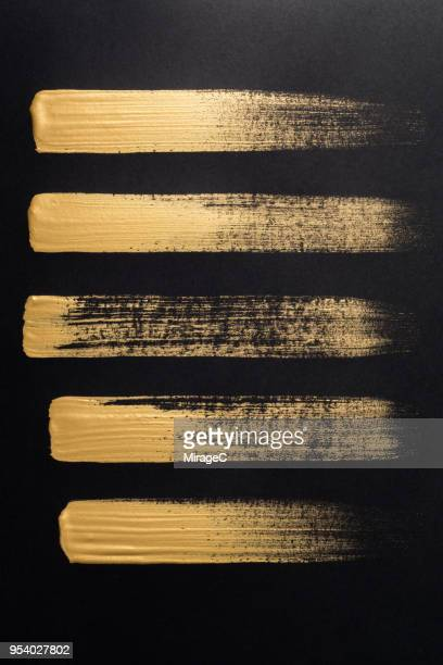 straight gold brush strokes - paintbrush stock pictures, royalty-free photos & images