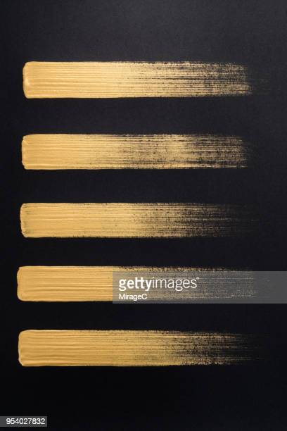 straight gold brush strokes - line pattern stock pictures, royalty-free photos & images