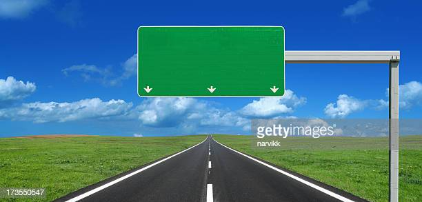 straight highway with blank roadsign - road sign stock pictures, royalty-free photos & images