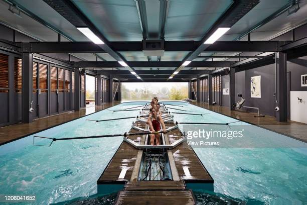 Straight on view of students rowing Radley Rowing Centre Oxford United Kingdom Architect Mulroy Architects 2016