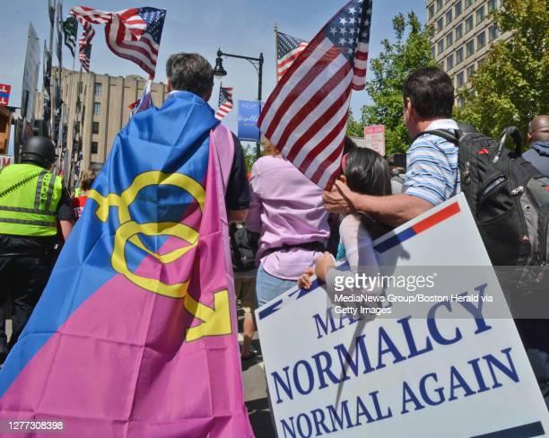 Straight Pride Parade marchers make their way down Cambridge Street August 31, 2019 in BOSTON, Massachusetts.