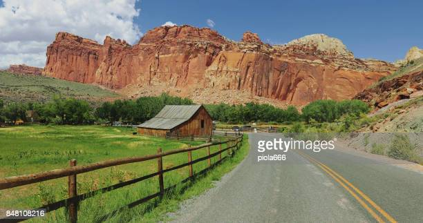 straight road in the capitol reef national park, utah - capitol reef national park stock pictures, royalty-free photos & images