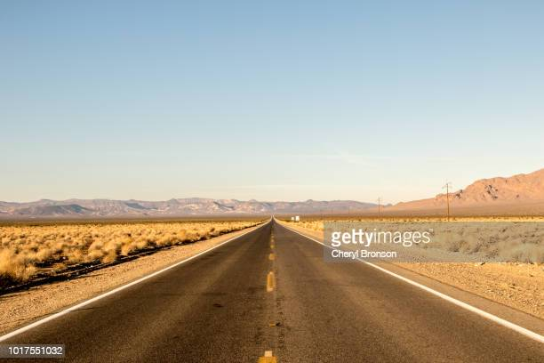 straight road in the desert - straight stock pictures, royalty-free photos & images