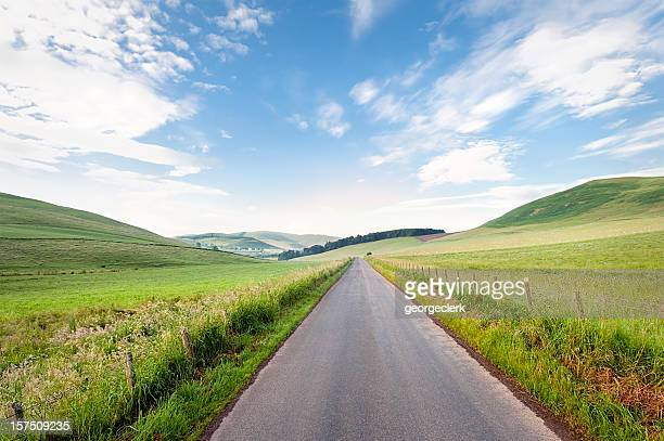straight scottish country road - british culture stock pictures, royalty-free photos & images
