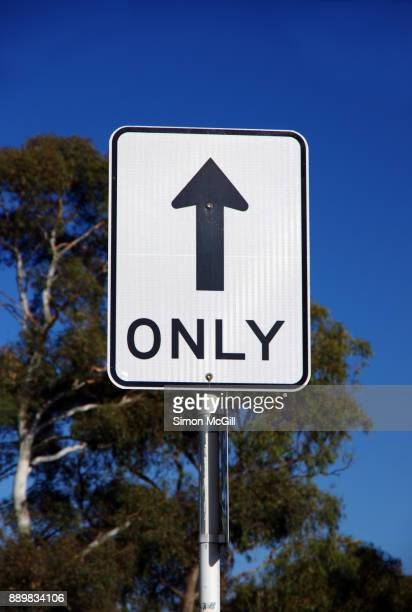 straight through only road sign - one direction stock pictures, royalty-free photos & images