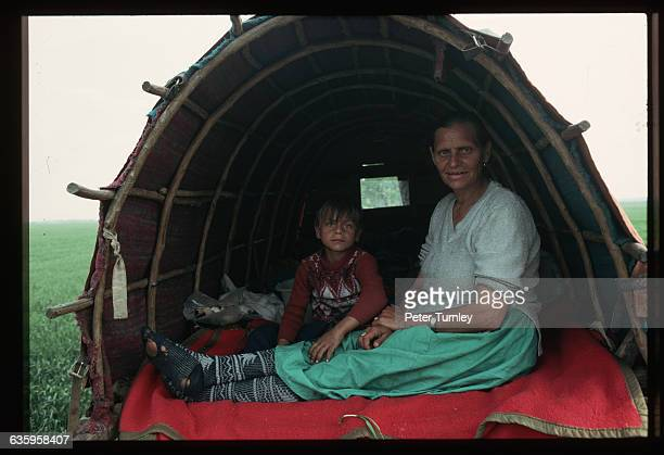 Straightforward Stares from Gypsies Sitting in a Covered Wagon