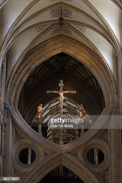 Strainer arches and crucifixion west facade of Wells cathedral English Gothic style Somerset United Kingdom