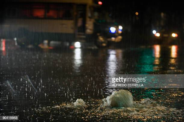 A strainer with water of drainage in a street during a storm in a neighborhood of Mexico City on Septemer 6 2009 AFP PHOTO/Alfredo ESTRELLA
