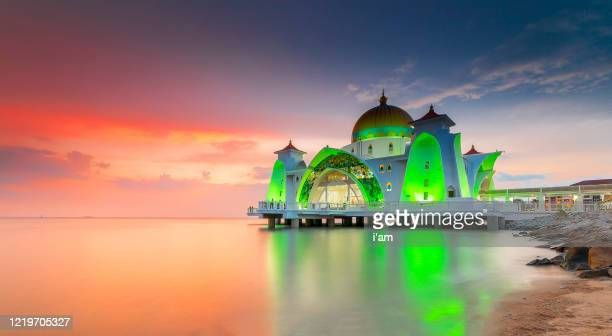 strait mosque / masjid selat during sunrise in malacca, malaysia. - eid ul fitr stock pictures, royalty-free photos & images