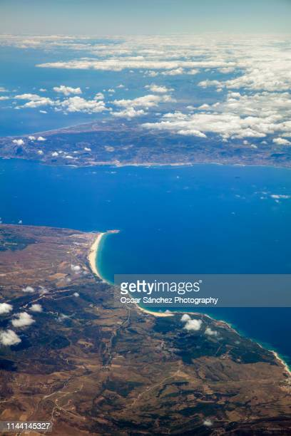 strait of gibraltar, aerial view of the separation between the continents of europe and africa and the union of the mediterranean sea and the atlantic ocean. - europa kontinent stock-fotos und bilder