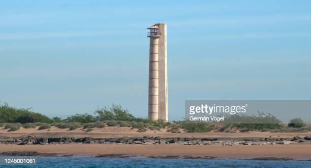 strait of hormuz lighthouse by beach of larak island, persian gulf, iran - iran stock pictures, royalty-free photos & images