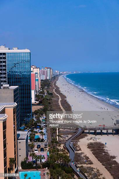 strand and part of boardwalk - dustin abbott stock pictures, royalty-free photos & images