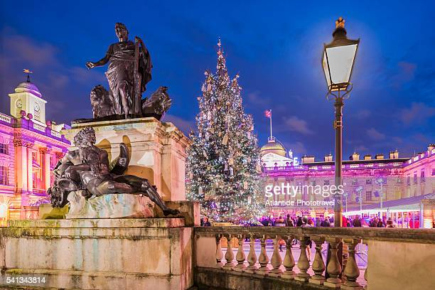 strand, somerset house, the george iii with the river god and a christmas tree near the ice skating rink - statue stock pictures, royalty-free photos & images
