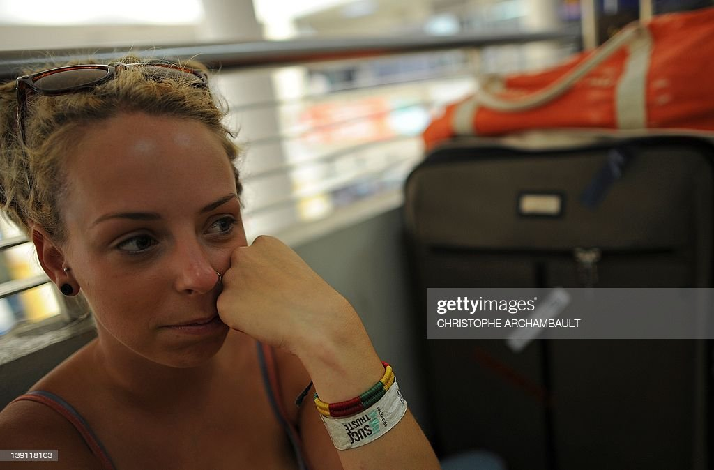 A stranded Air Australia passenger waits with her luggage at Phuket international airport after her flight was cancelled on February 17, 2012. Budget carrier Air Australia collapsed on February 17, stranding thousands of passengers as its domestic flights and international services to Honolulu, Bali and Phuket were all grounded. AFP PHOTO/Christophe ARCHAMBAULT