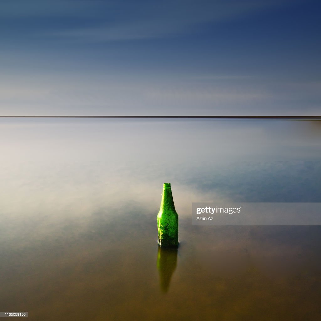 Stranded Bottle by the Sea : Stock Photo