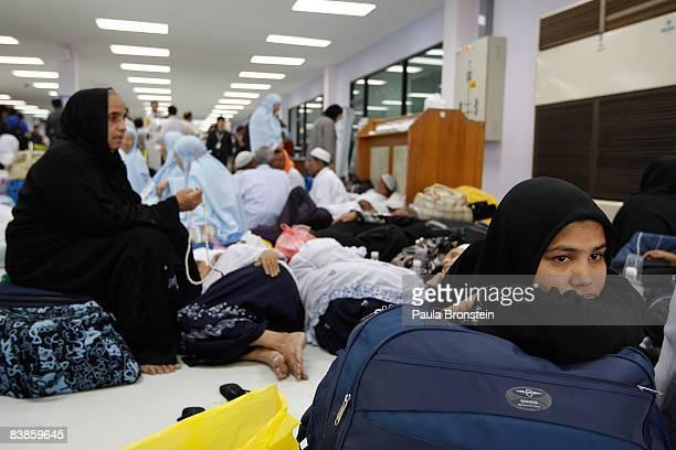 Stranded Burmese pilgrims wait for a flight to attend the Hajj, at U-Tapao military airport on November 30 165 kilometers south of Bangkok, Thailand....