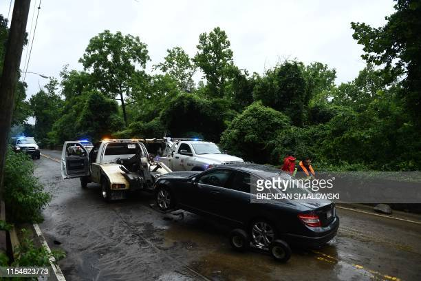 A stranded car is towed after the rain storm on Canal Road on July 8 2019 in WashingtonDC