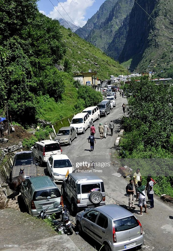 Stranded cars along the river Alaknanda since the day of flash flood as the road to Joshimath has been washed away at Govind Ghat on June 30 2013 in Uttarakhand, India. People who are stranded at Badrinath got agitated as their token for helicopter rescue are being mismanaged and henceforth opted to walk down through mountains.