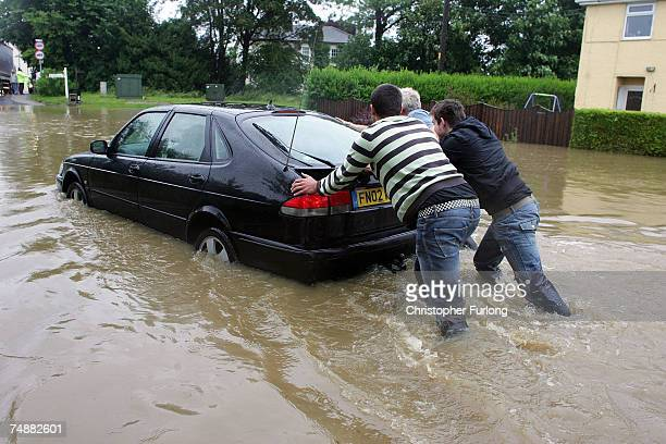 Stranded cars and residents battle the flood waters in the village of North Cave, near Hull in northern England on 25 June Hull, England. Much of...