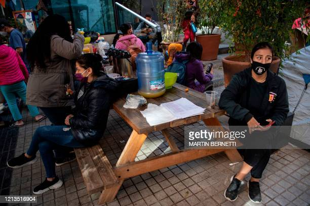 Stranded Colombian citizens remain outside Colombia's consulate in Santiago on May 18 as they wait for a solution after the borders were closed due...