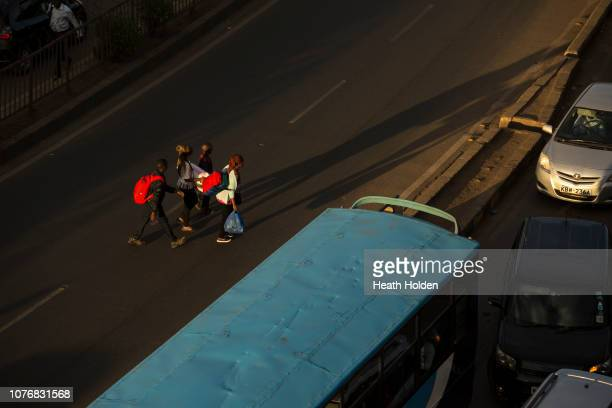 NAIROBI KENYA DECEMBER 3 Stranded commuters are forced to walk for hours to make their public transport connection on opposite sides of the city...