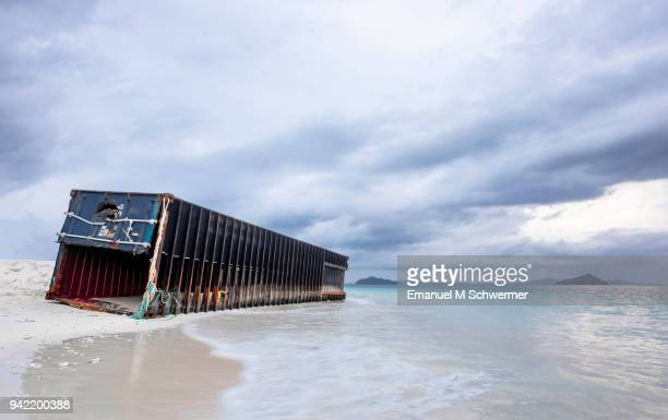 stranded container on the beach of Ko Bulon Lea island in Thailand