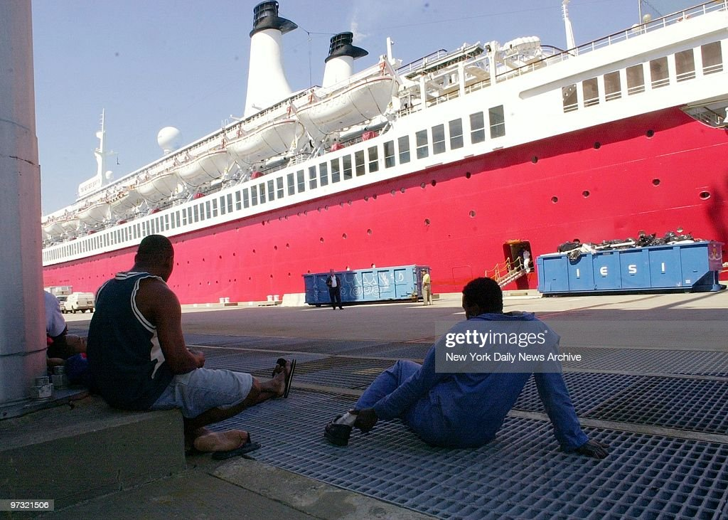 stranded crew members look at their ship the big red boat ii tied