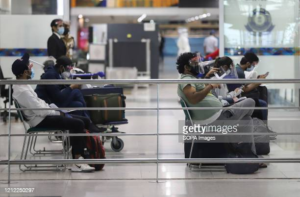 Stranded Indian passengers who arrived by an Air India flight from Singapore wait at the Indira Gandhi international airport India has started a very...