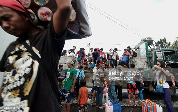 TOPSHOT Stranded passengers from Tabaco port are evacuated by the local government in Tabaco City Albay province on December 24 2016 after their...