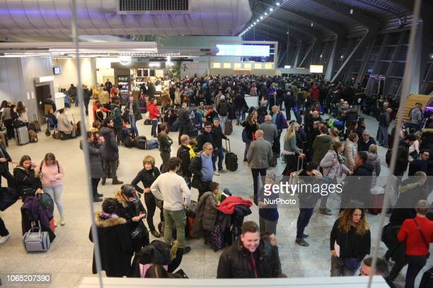 Stranded Passengers in Eindhoven Airport in the Netherlands due to fog and the deteriorating weather conditions that led to low visibility causing...