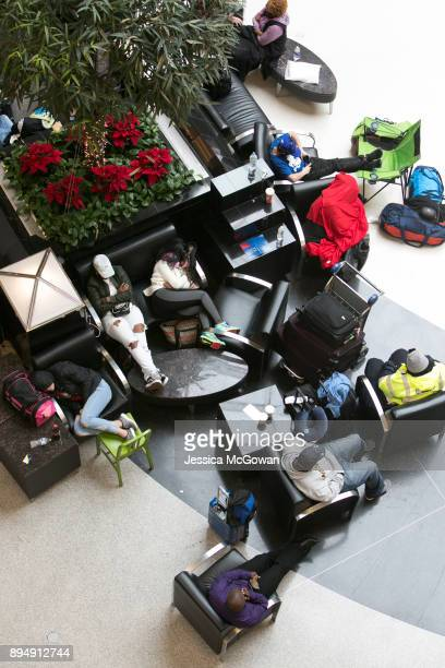 Stranded passengers sleep and relax in the atrium HartsfieldJackson Atlanta International Airport on December 18 2017 in Atlanta Georgia Hundreds of...