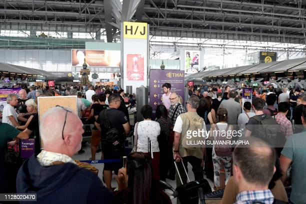Stranded passengers wait at the checkin area at the Suvarnabhumi International Airport in Bangkok on February 28 2019 Thai airways cancelled 11...