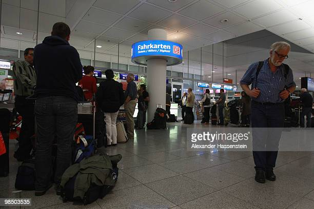 Stranded passengers wait for train tickets at Munich Airport on April 16 2010 in Munich Germany Munich Franz Josef Strauss Airport was closed due to...