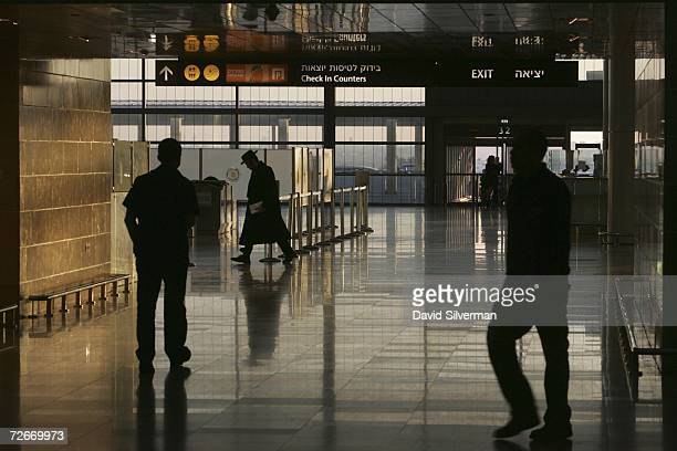 Stranded passengers walk through the otherwise deserted departures hall after their flight was cancelled due to a general strike that left scores of...