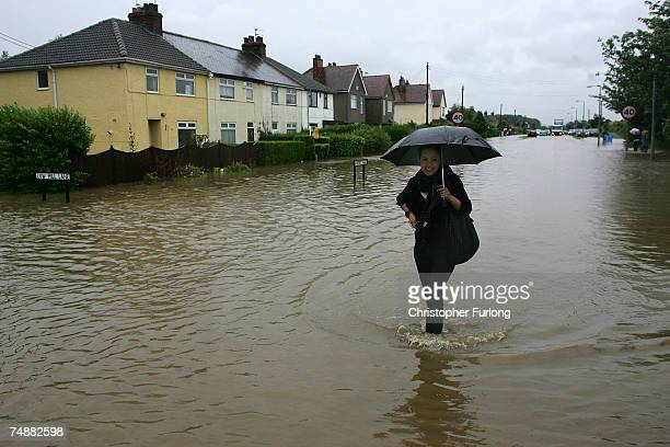 Stranded residents battle the flood waters in the village of North Cave, near Hull in northern England on 25 June Hull, England. Much of Britain was...