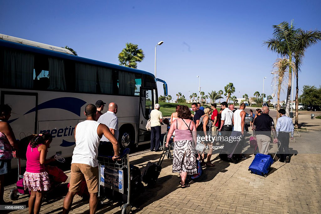 Stranded tourists are loaded onto a bus for the next leg of their journey outside the airport terminal on November 05, 2015 in Sharm El-Sheikh, Egypt. If the tourism industry in Egypt collapses, workers who rely on the tourist industry could lose their income. British flights going to and from the Egyptian resort were grounded today, as investigations continue into the crash of a Russian Airbus-321 earlier this week. This will affect around 20,000 British tourists currently in Sharm El-Sheikh according to Downing Street.
