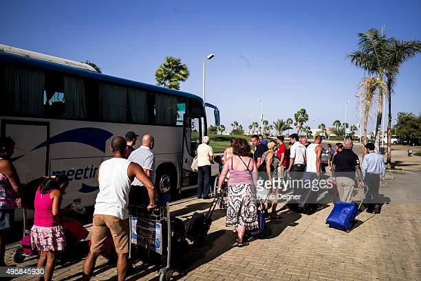 Stranded tourists are loaded onto a bus for the next leg of their journey outside the airport terminal on November 05 2015 in Sharm ElSheikh Egypt If...