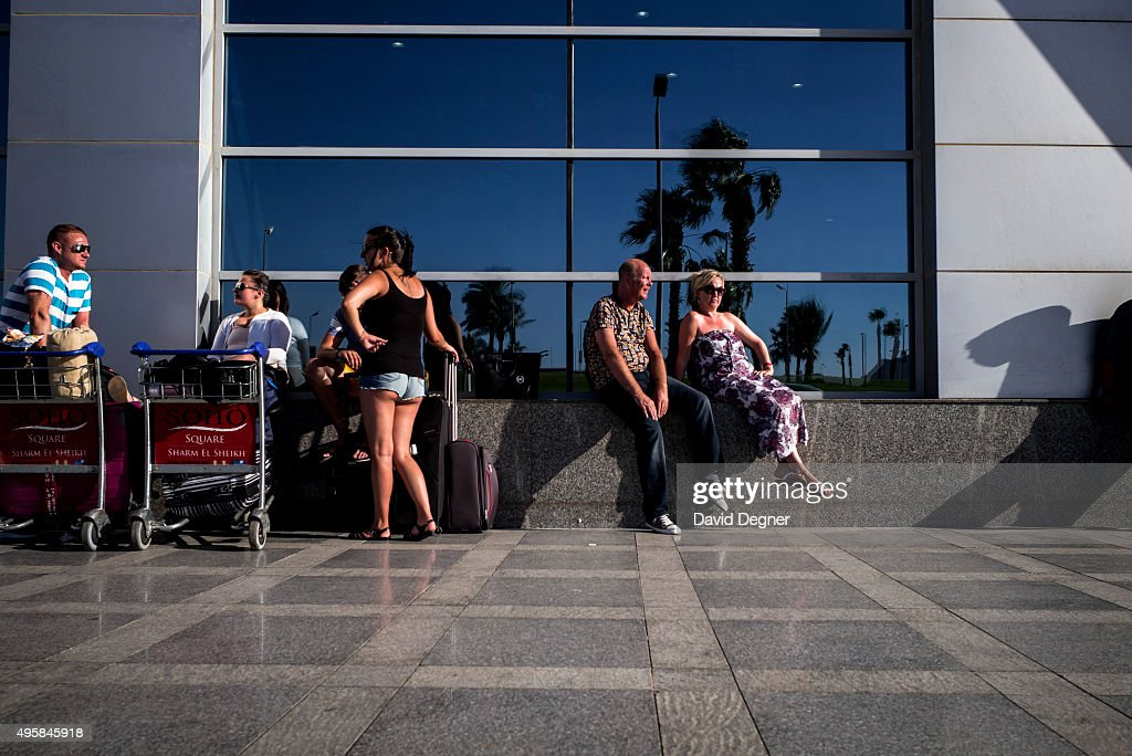 Stranded tourists wait outside the airport terminal for information on a flight on November 05, 2015 in Sharm El-Sheikh, Egypt. If the tourism industry in Egypt collapses, workers who rely on the tourist industry could lose their income. British flights going to and from the Egyptian resort were grounded today, as investigations continue into the crash of a Russian Airbus-321 earlier this week. This will affect around 20,000 British tourists currently in Sharm El-Sheikh according to Downing Street.