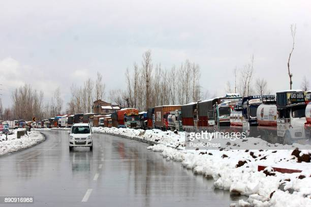 Stranded truck drivers gossip next to their vehicles on closed SrinagarJammu highway on December 12 2017 in Lower Munda 85 km south of Srinagar the...
