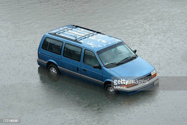 stranded van in rising flood waters