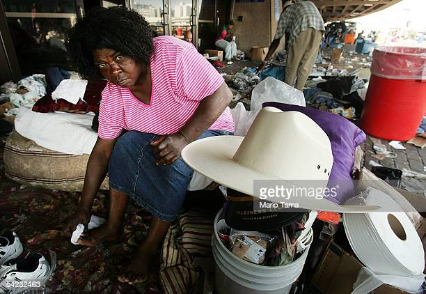 A stranded victim of Hurricane Katrina waits outside the Superdome to be evacuated September 2 2005 in New Orleans Lousiana Thousands of troops...