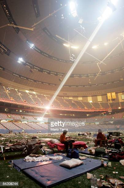 Stranded victims of Hurricane Katrina rest inside the Superdome September 2 2005 in New Orleans Thousands of troops poured into the city September 2...