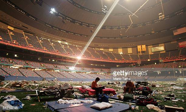 Stranded victims of Hurricane Katrina rest inside the Superdome September 2, 2005 in New Orleans. Thousands of troops poured into the city September...